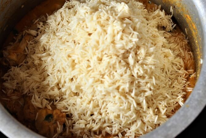 rice added in the south indian chicken biryani yakhni