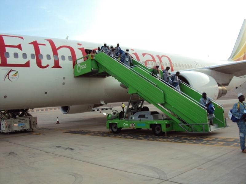 Les pèlerins à leur descente d'avion