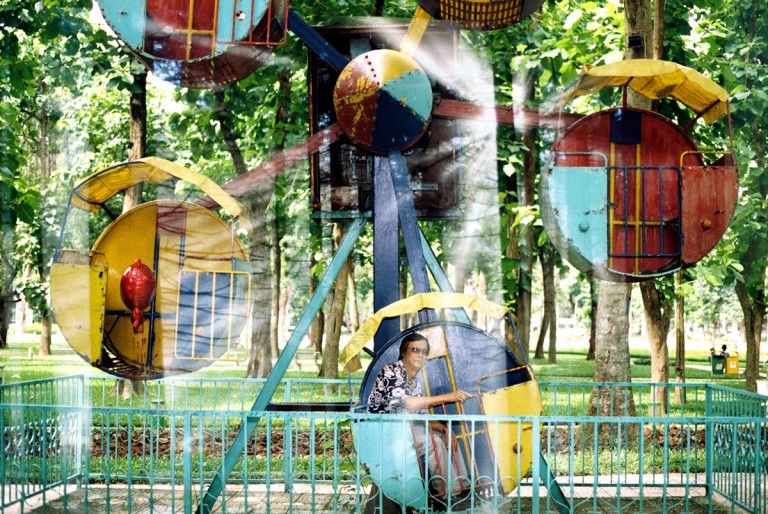 My father and the baby swings in the Lenin park in Hanoi, Viet Nam on August 2013.