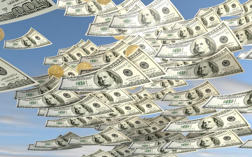 100 dollar bills floating