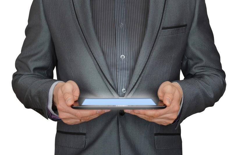 Man holding tablet