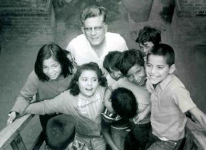 Father Thomas surrounded by children