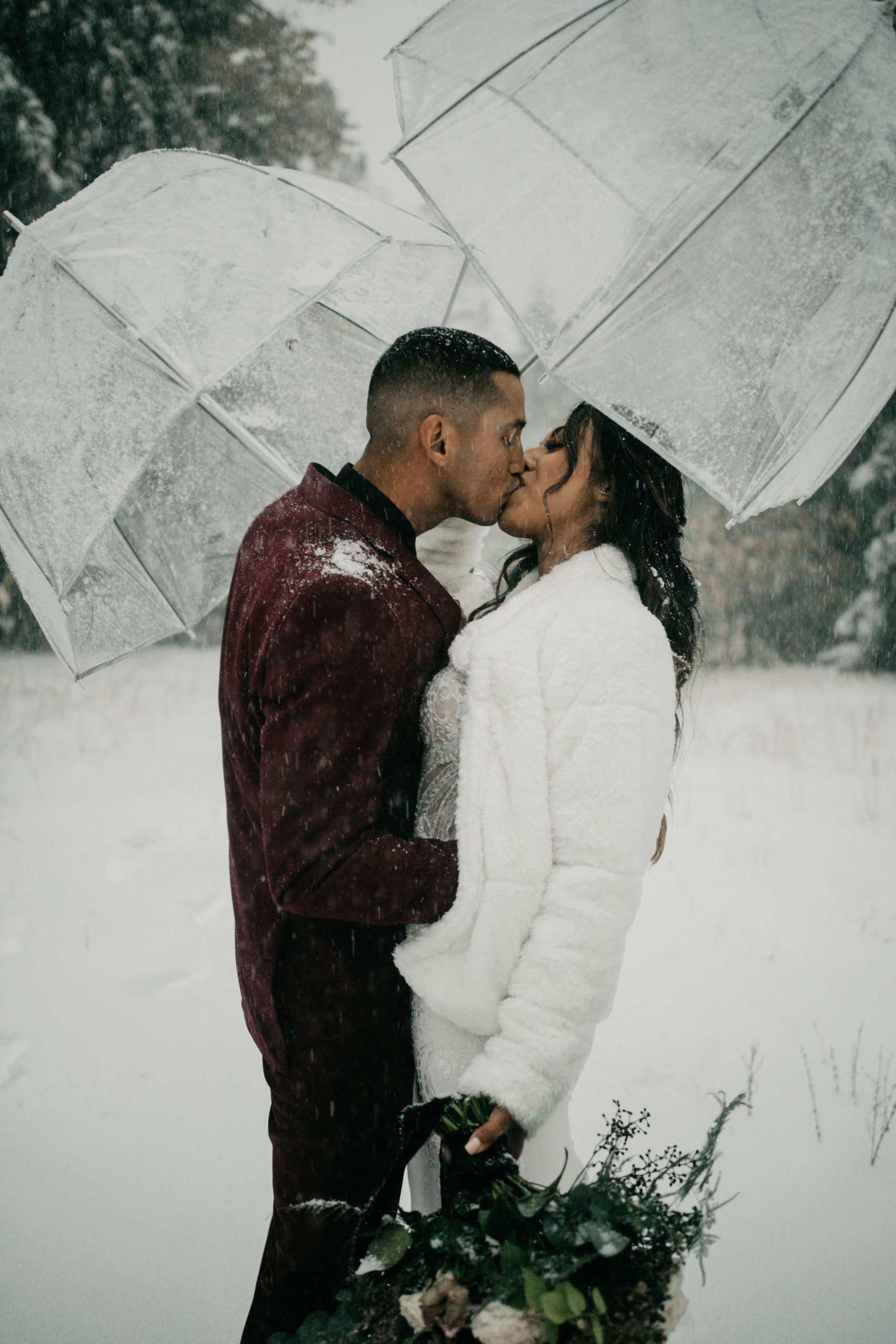 Bride and Groom portraits in the snow near Arrowhead Pine Rose Wedding, image by Fatima Elreda Photo