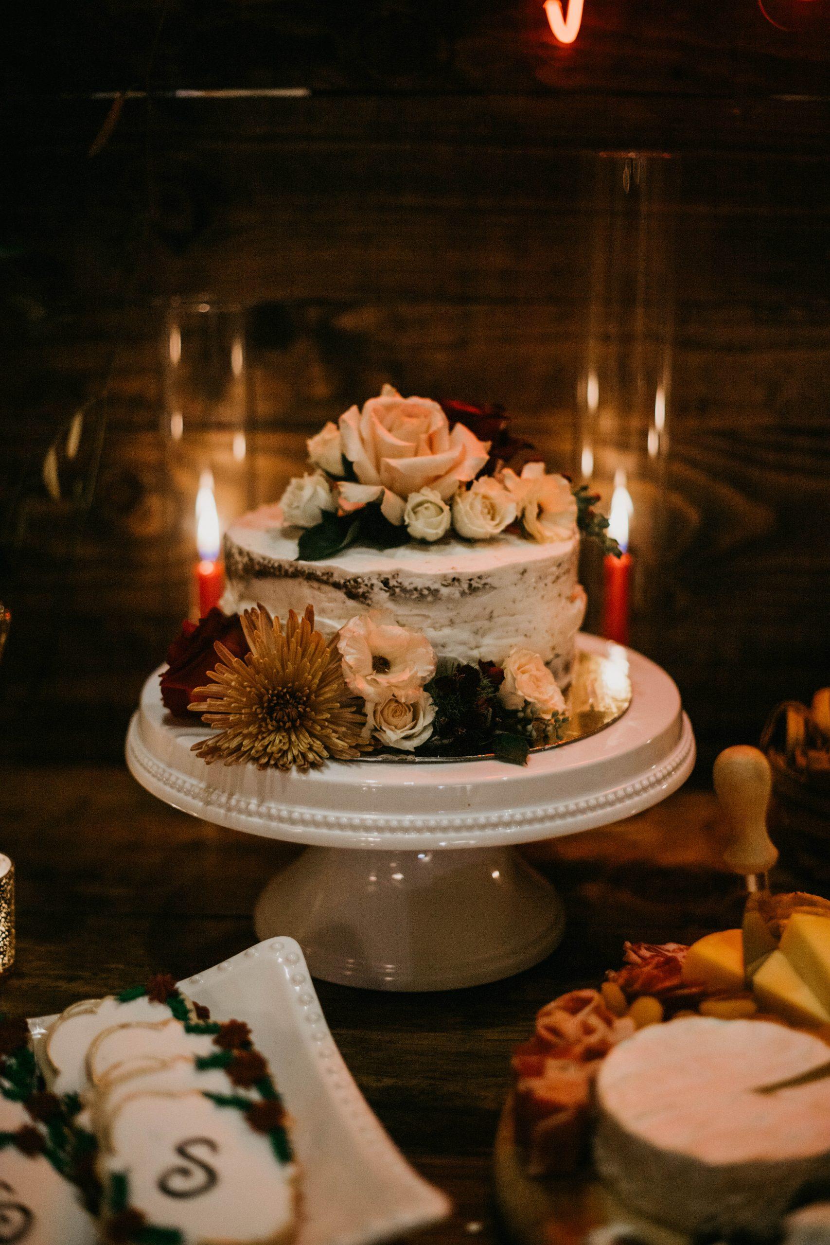 Small floral wedding cake, image by Fatima Elreda Photo