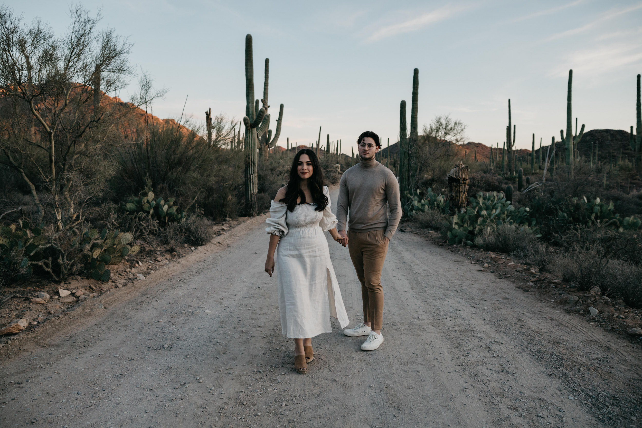 Couple posing for photo in the desert, image by Fatima Elreda Photo
