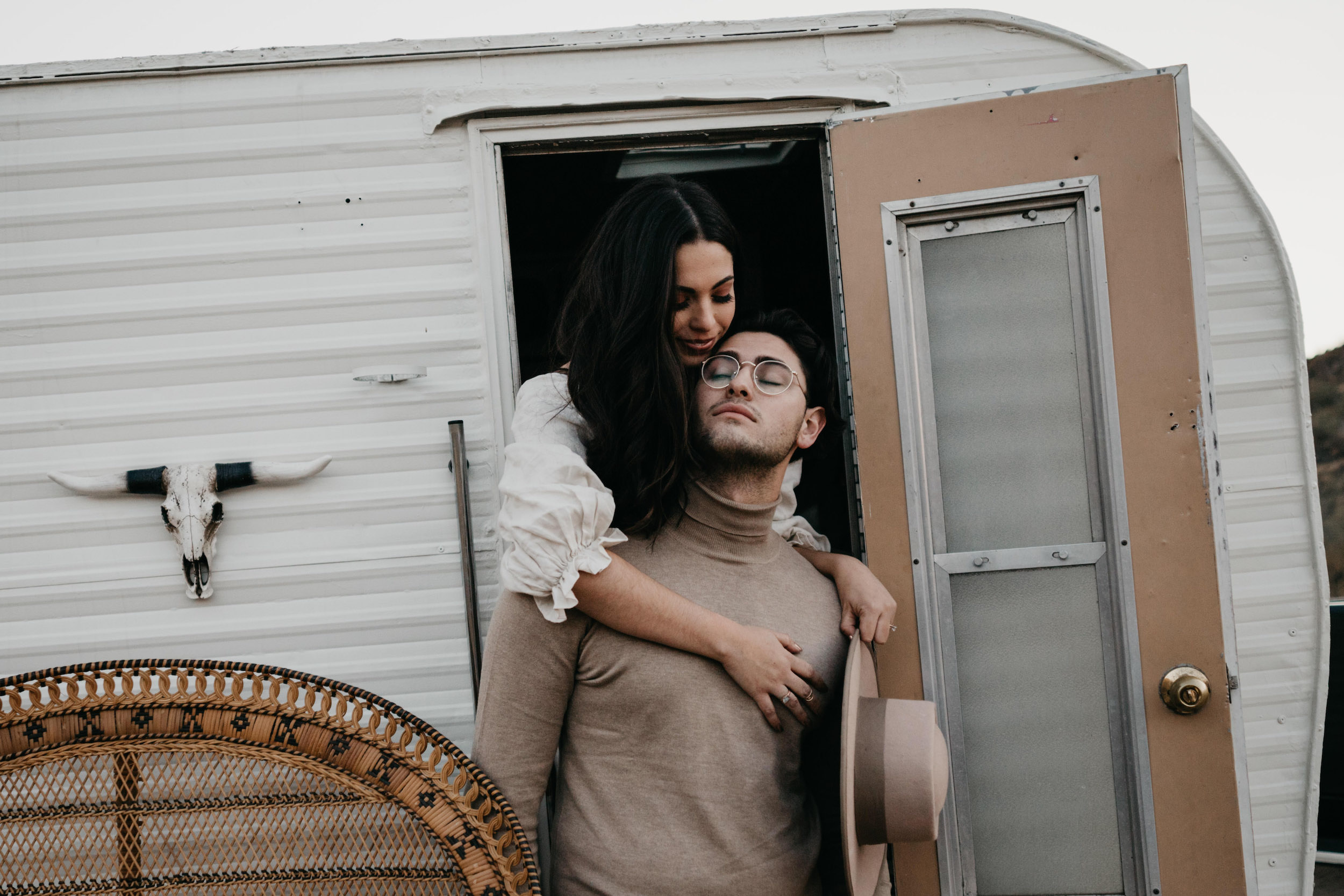 Couple posing in front of their airstream, image by Fatima Elreda Photo