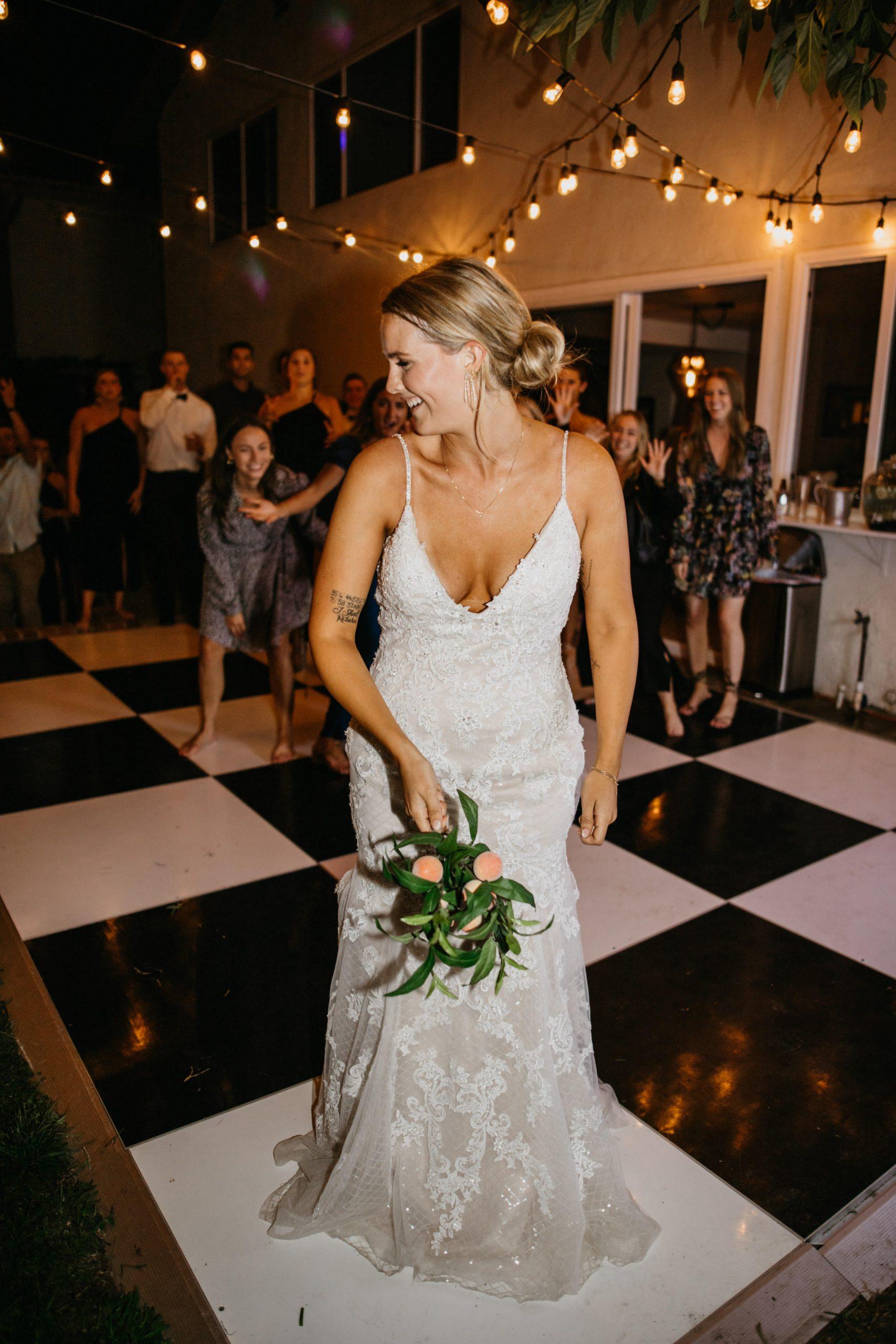 Bouquet toss in Laguna Beach Backyard Wedding, image by Fatima Elreda Photo