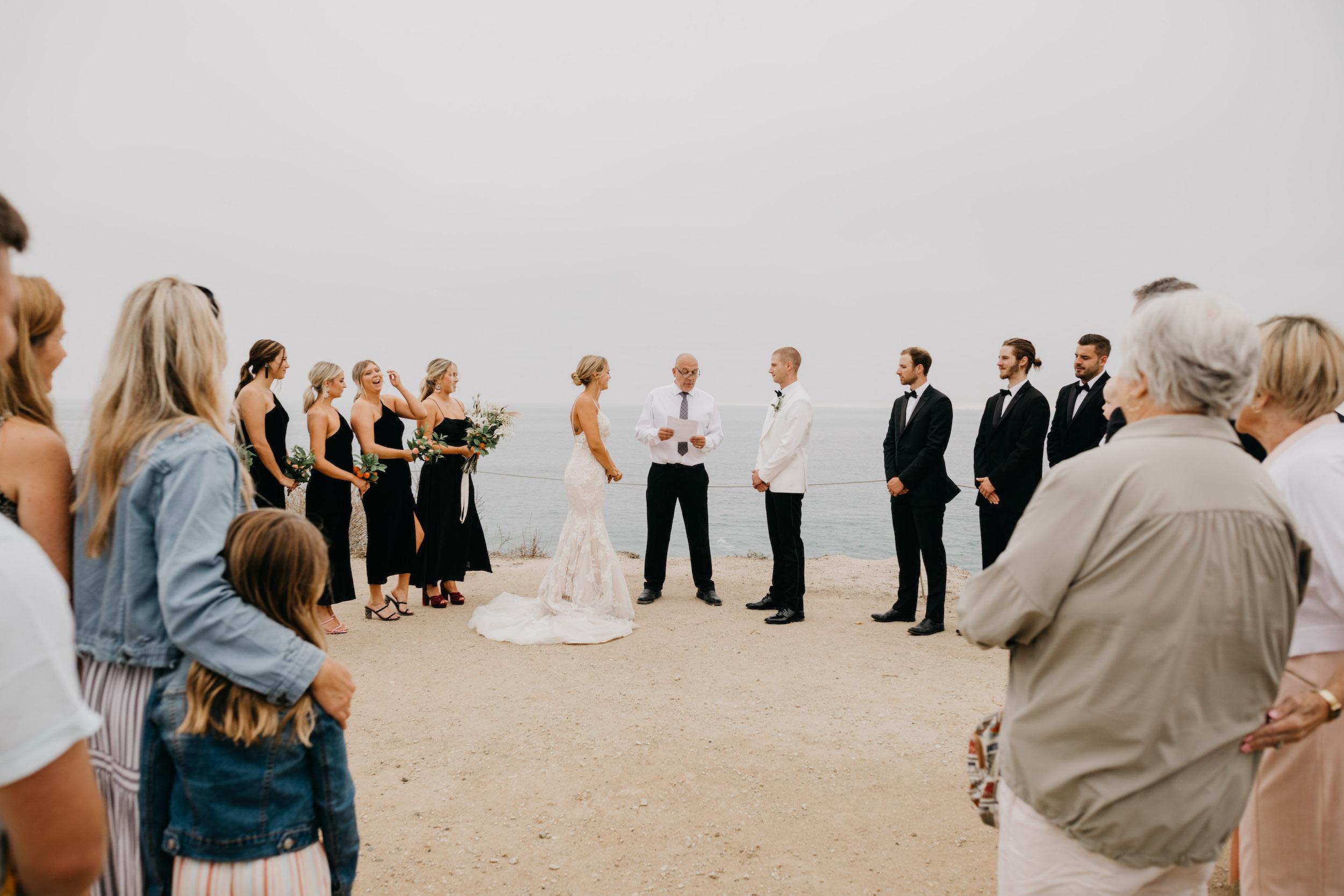 Ceremony in Crystal Cove State Park Wedding in Laguna Beach, image by Fatima Elreda Photo