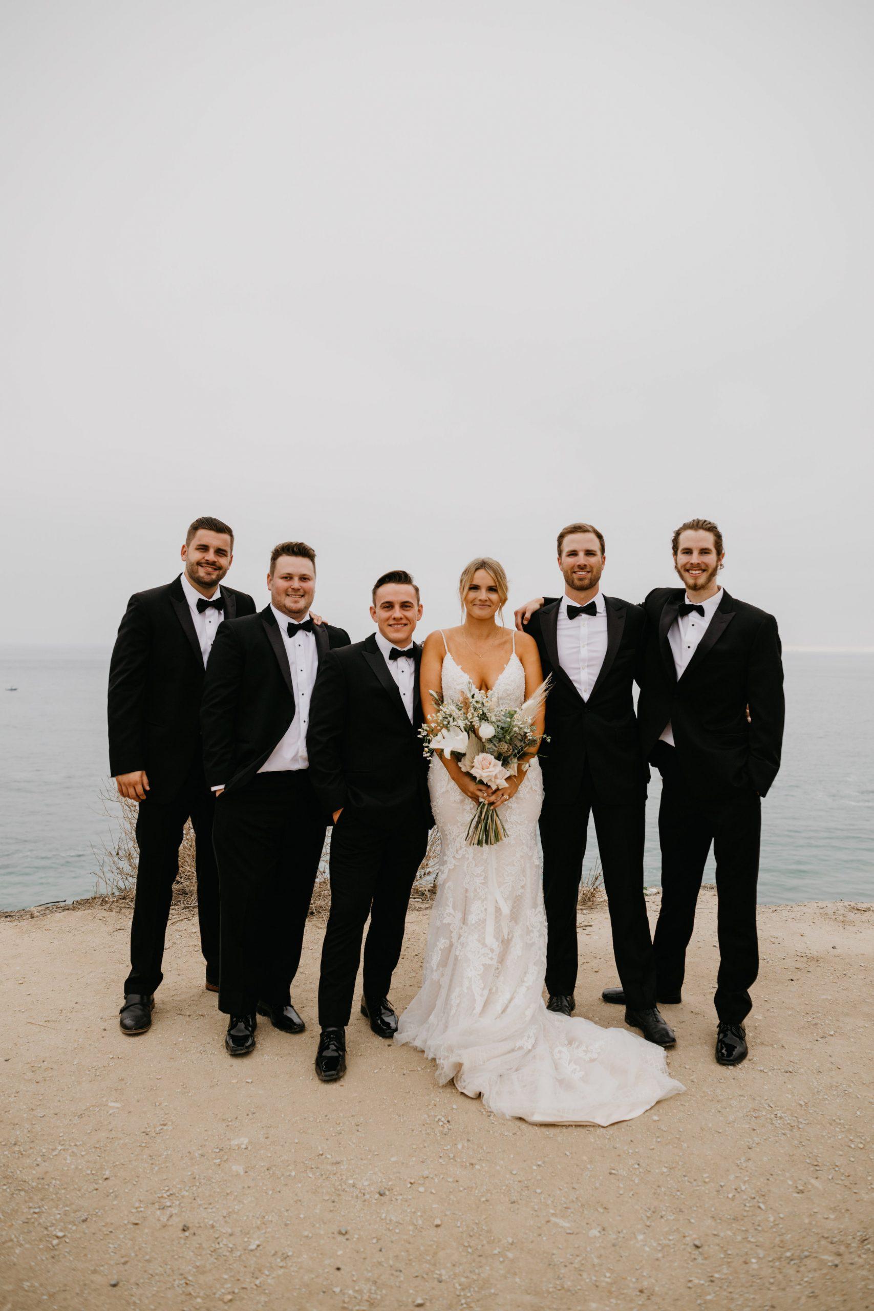 Bride and Groomsmen in Crystal Cove State Park Wedding in Laguna Beach, image by Fatima Elreda Photo