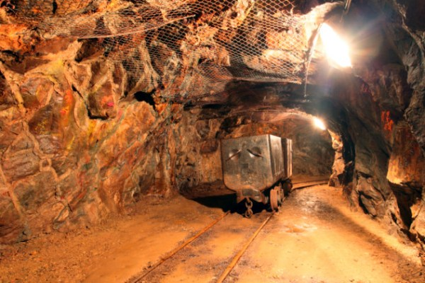 Tunnel with mining machine in gold silver and copper mine