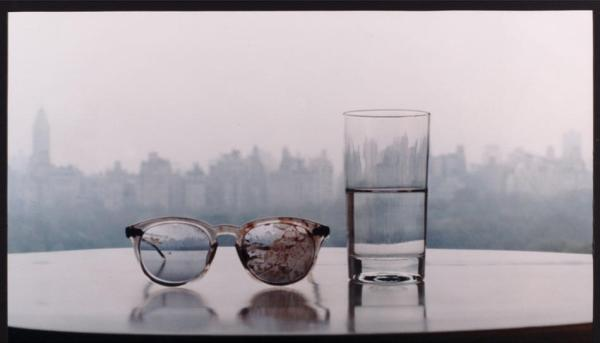 """This limited editon photograph entitled """"Season of Glass"""", by Yoko Ono, taken in 1981 and printed in 1994, showing John Lennon's blood covered glasses from his assassination, placed on a table with a glass of water, and taken in the couple's Dakota apartment overlooking New York's Central park, was made available in London, Friday April 12, 2002, to be sold by auctioneers Bonhams in London, scheduled for April 17. The photograph, one of six, was expected to fetch between 8,000 and 10,000 Pounds (US$ 11,440 and 14,300) in aid of artists' charity. (AP Photo/Yoko Ono, Bonhams)"""