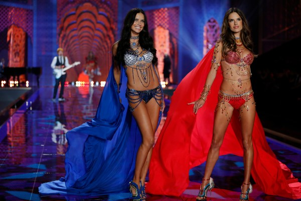Adriana Lima and Alessandra Ambrosio walk the runway at the 2014 Victoria's Secret Fashion Show in London on December 2nd, 2014