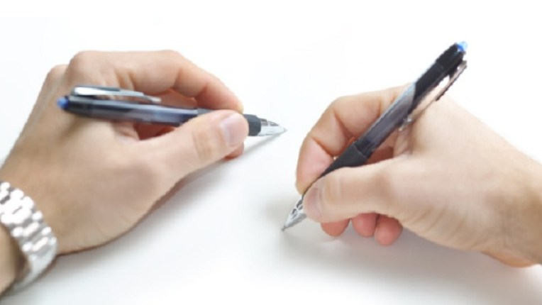 Two hands writing