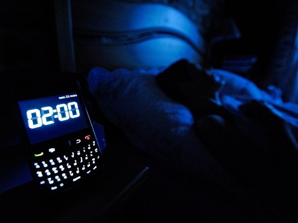 v2-pg-38-sleeping-with-phone-getty
