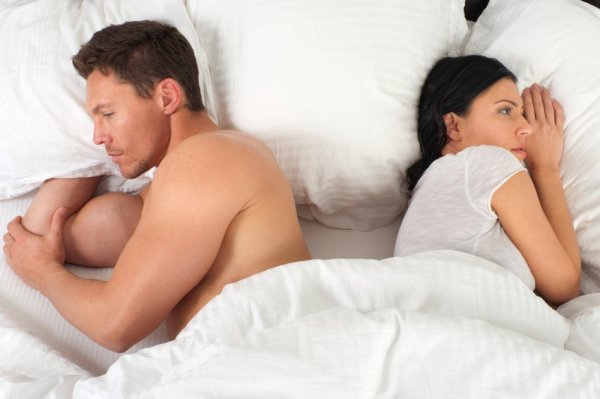 Young couple with problems in the bedroom