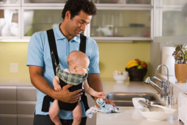 Father with baby in a baby carrier