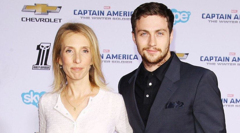"""HOLLYWOOD, CA - MARCH 13: Sam Taylor-Wood (L) and Aaron Taylor-Johnson arrives at the Los Angeles premiere of """"Captain America: The Winter Soldier"""" held at the El Capitan Theatre on March 13, 2014 in Hollywood, California. (Photo by Michael Tran/FilmMagic)"""