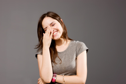 Girl Laughing With Hand On Face