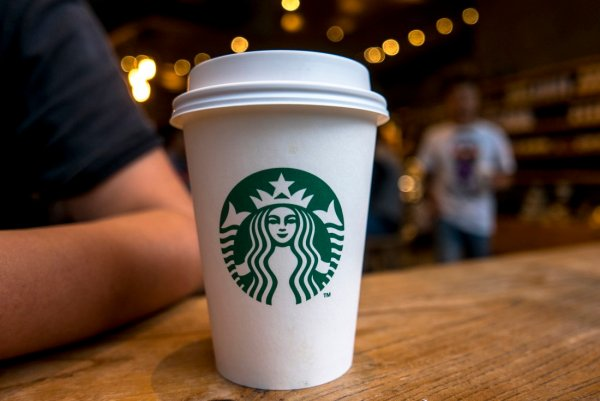 CHENGDU, SICHUAN PROVINCE, CHINA - 2015/09/13: Coffee cup on table in a Starbucks cafe. Starbucks is streamlining the ordering process so customers are able to get that cup of coffee faster than usual. (Photo by Zhang Peng/LightRocket via Getty Images)