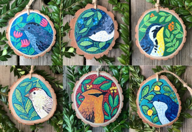 group of hand painted bird ornaments
