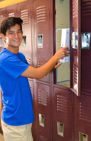 student standing in front of lockers