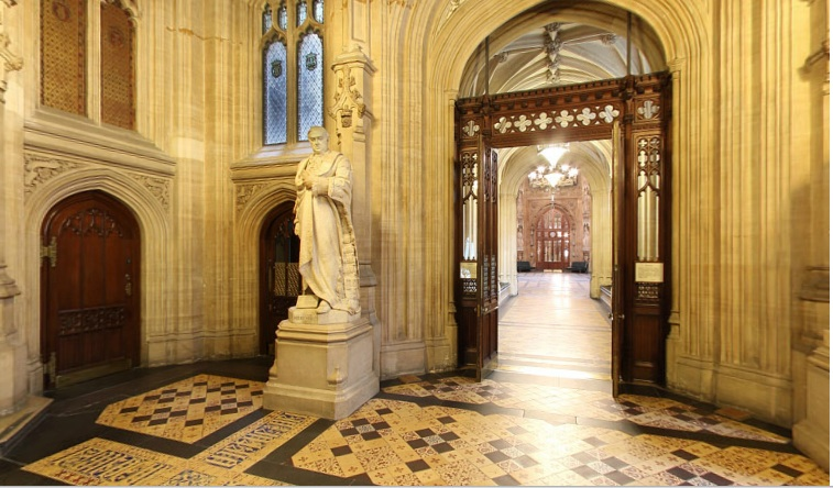 Marble hallway with statues and tiled flooring: very grand!