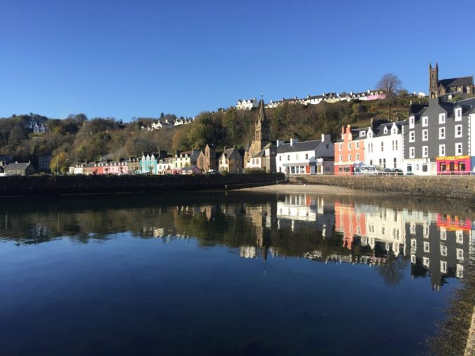 On the way to Tobermory Book Festival, A flat calm surface reflects the colours of Tobermory Main Street, October 2018