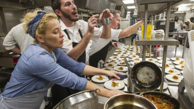 Local chefs and cooks line up dozens of plates as they prepare dinner at the Audubon Nature Institute's Gulf United for Lasting Fisheries (G.U.L.F.) dinner at the Aquarium of Americas in New Orleans on Thursday, September 24, 2015. (Photo by Chris Granger, Nola.com   The Times-Picayune)