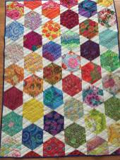This was made as a fundraising prize for the Treasure Coast Walk with Compassion 2016. It was made with the Hex'n'more ruler by Jaybird Quilts using Kaffe Fassett fabrics.