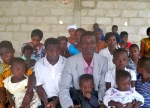 Pastor Collins Agyei with several church members