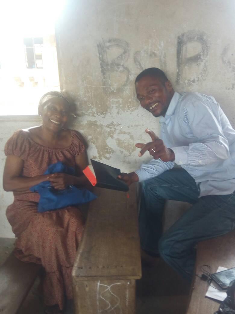 Pastor Gyasi Boateng with convert Madam Sarfowah
