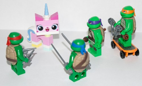 I have no reason for taking the picture like this... Unikitty just happened to be by the Turtles on my shelf