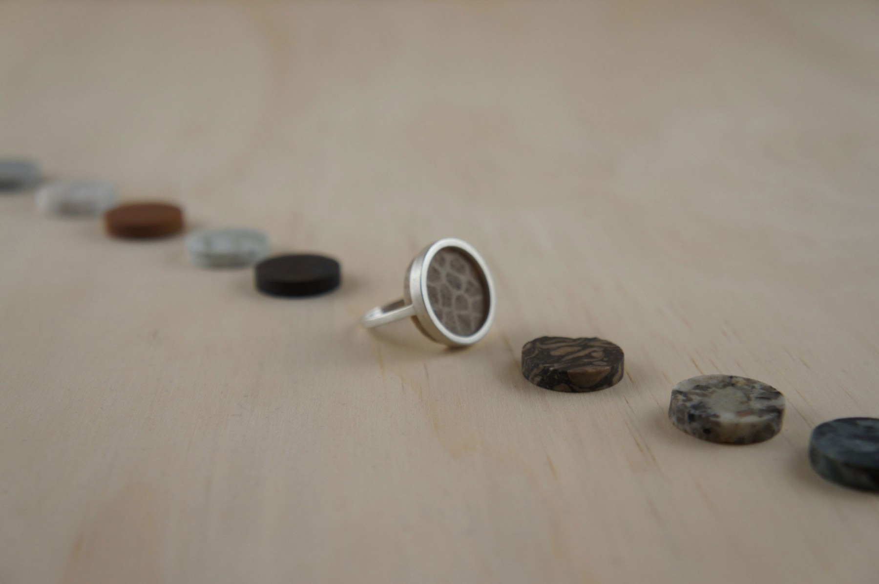 Stefanie Cheong's interchangeable ring with a selection of cut stones