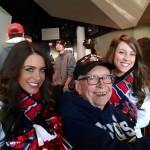 Patriots Cheerleaders join Foxborough resident and World War II veteran Edward Mousseau at The Hall at Patriot Place presented by Raytheon prior to Sunday's Patriots-Lions game at Gillette Stadium.