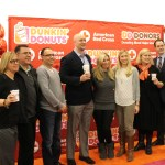"""Dunkin' Donuts and American Red Cross representatives pose for a photo with Boston Marathon bombing survivor Heather Abbott (center) and former Patriots linebacker Matt Chatham (left of Abbott) and his wife, Erin (right of Abbott) at Friday's blood drive at Patriot Place. The blood drive launched the campaign, """"Dunkin' Donors Make A Difference,"""" to help raise awareness about the need for blood and platelet donations during National Volunteer Blood Donor Month."""