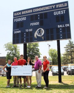 From left to right: Partners in Patriotism Fund Grant Committee member Cindy Venuto, Grants Committee Vice Chair Mark Powers, Foxborough High School senior Brian DeVellis, Foxborough High School Class of 2015 President Kayla Sepe, Grants Committee Chair Jimmy McGowan and Grants Committee member Livia Binks. The Partners in Patriotism Fund, established by the Kraft family in 2014, recently donated $5,000 to the FHS Class of 2015 to assist the departing seniors in building a garden in memory of their classmate, Sam Berns.