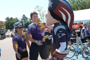 Massachusetts Governor Charlie Baker is greeted by Patriots mascot Pat Patriot after crossing the finish line of the 2015 Pan-Mass Challenge's Wellesley Loop route at Patriot Place on Sunday, Aug. 2. Gov. Baker and Boston City Mayor Marty Walsh rode the 27-mile course to benefit cancer research.