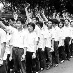 Teenage demonstrators hold up the Little Red Book in front of the Government House, May 1967. Credit: SCMP