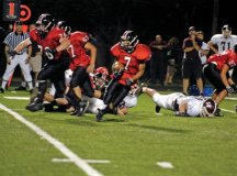 Antoneo Folks carries the ball for Mason last Friday night. The Mustangs cruised 28-0. (Photo: Elizabeth Morrison)
