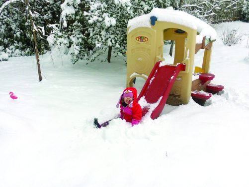 Celeste E. Ognibene, 3, of Falls Church said her favorite part of Sunday's winter wonderland was going down a snowy slide and plopping down in a big pile of it. She loves sledding down her driveway, making snow angels, and putting buttons on snowmen and women. (Photo courtesy: Dave Gustafson)