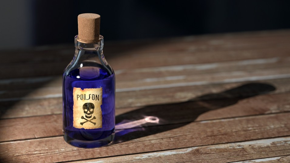 Small blue bottle of poison