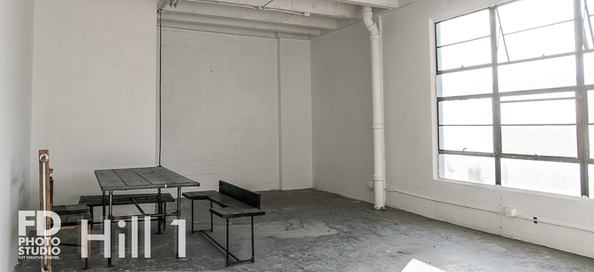 Rent Photo Studio Los Angeles Hill 1 natural light stage with artsy kitchen table
