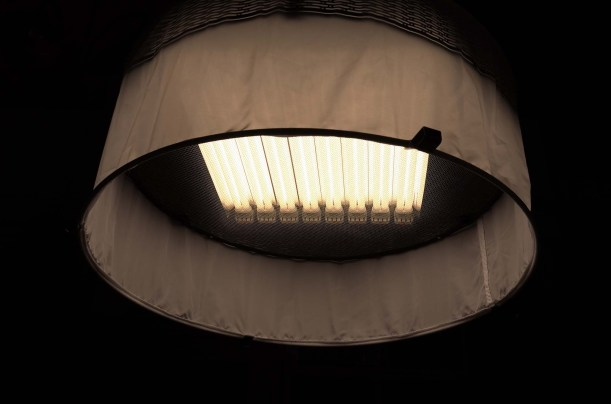 Florescent bulbs inside shallow Mole Ricardson Space Light. Good for stages with low ceilings (Quixote on N. Fuller Ave).