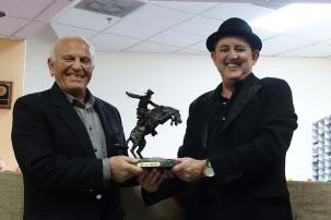 """Amnon presenting Enzo with Frederick Remington's """"The Broncho Buster"""""""