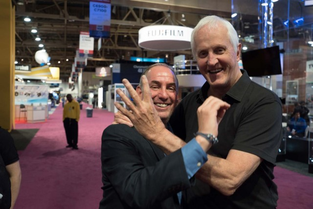 Steve Tiffen and Garrett Brown celebrating the 40th anniversary of Steadicam at Tiffen's NAB 2015 Booth.