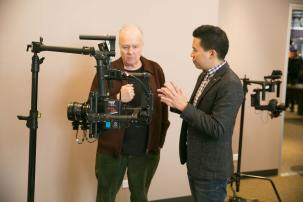 Chicago director John McNaughton (left) talks gear with AbelCine Training Manager Jeff Lee.