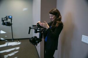 Camera Technology Specialist Megan Donnelly prepares gear for the Chicago Open House.