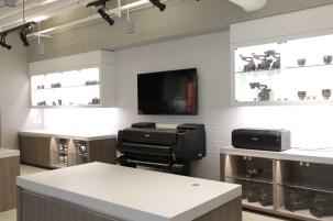 Equipment exhibit area and printers.