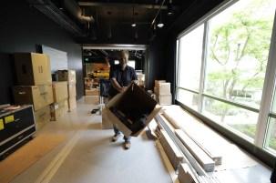 Joe Bogacz unpacking monitors in studio