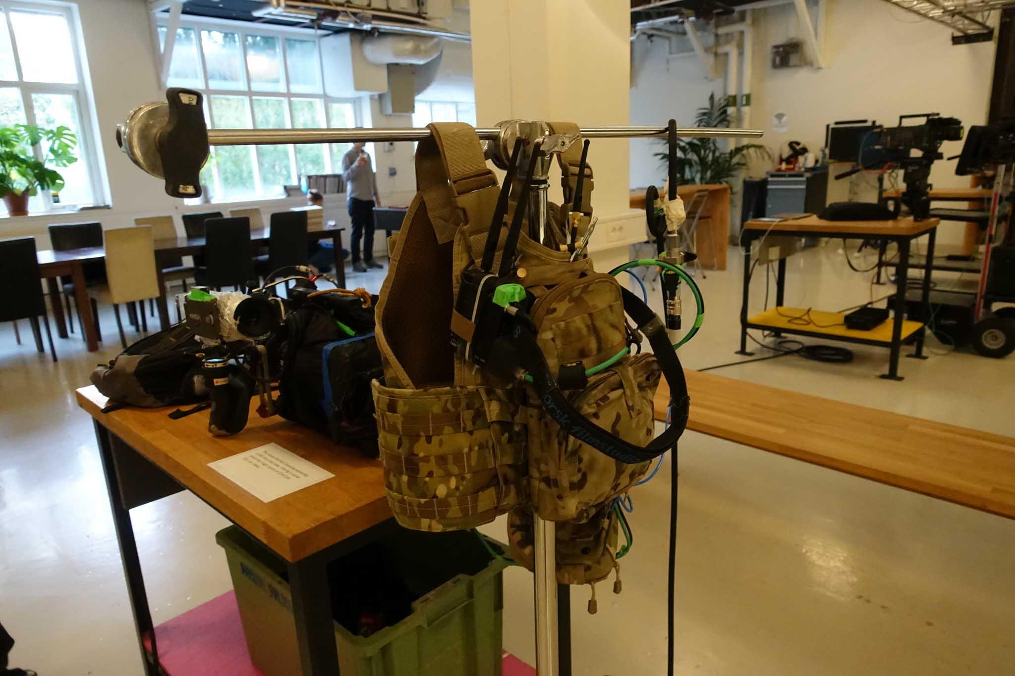 Operator's custom vest with batteries, Teradek Bolt 3000 transmitter, air cannister for lens nozzles.
